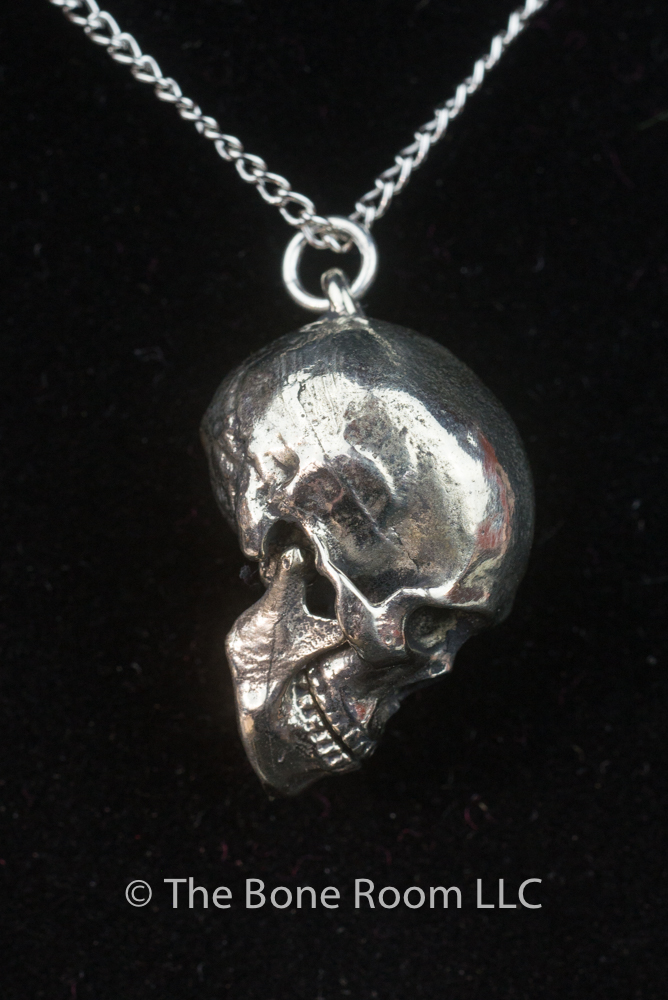 mainye in gold diamond skull pendant iced black white and out